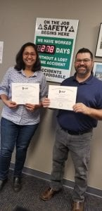 Two Happy People with Certificates
